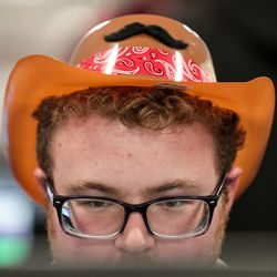 """Michael Gardone, who helped develop the game""""Ballad of the Masked Bandits,"""" tries out another game at EAE Play, the annual showcase for the Entertainment Arts and Engineering program, at the EAE Master Games Studio in Salt Lake City on Friday, Dec. 6, 2019."""