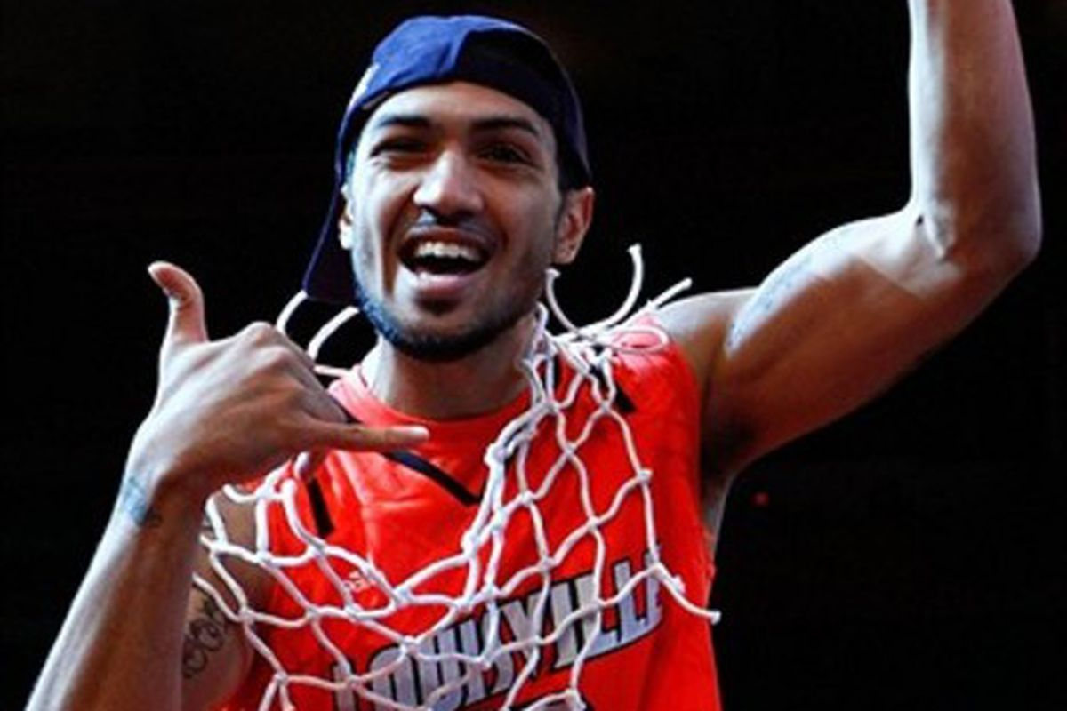 Louisville Cardinals guard Peyton Siva cuts down the net after winning the championship game, 50-44, against the Cincinnati Bearcats of the Big East Tournament at Madison Square Garden March 10 (Debby Wong-US PRESSWIRE).
