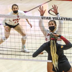 Utah's Dani Drews spikes the ball during a volleyball set against the Southern California Trojans at the Jon M. Huntsman Center at the University of Utah in Salt Lake City on Sunday, Feb. 14, 2021.
