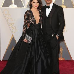 Best Supporting Actor nominee Tom Hardy rocking red carpet shades with Charlotte Riley. Photo: Todd Williamson/Getty Images