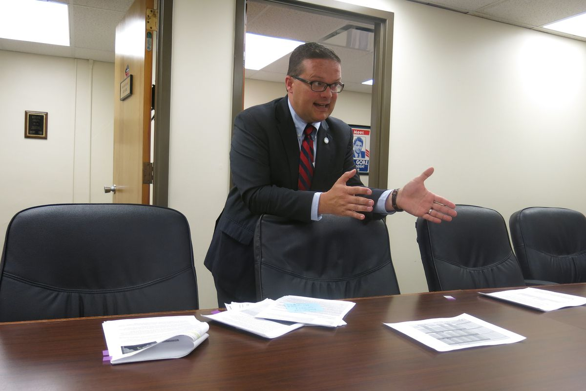 Rep. Kevin Dunlap talks to reporters at a press conference Thursday where he raised questions about the state's selection of Questar.