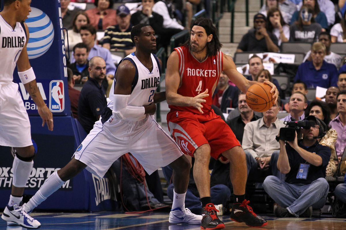 March 27, 2012; Dallas, TX, USA; Houston Rockets forward Luis Scola (4) with the ball on the block against Dallas Mavericks center Ian Mahinmi (28) at American Airlines Center.  Mandatory Credit: Matthew Emmons-US PRESSWIRE