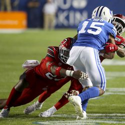 Utah Blackmon, 23, and Javelin Hydri, 28, a Utah defense team set out to knock down wide receiver Alley Hifo, 15, during a Utah-BYU football game at LaVell Edwards Soccer Stadium on Thursday in Provo. August 29, 2019.