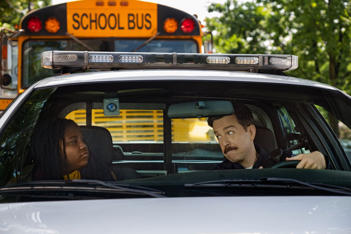 a boy and man sit in a car