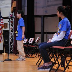 Seventh-grader Aaron Chang (left) from the Audubon Elementary School and Maya Joshi from the Young Magnet High School during one of the final rounds of the annual Citywide Spelling Bee Championship at the Lindblom Math and Science Academy on March 14, 2019. The winner will earn the opportunity to represent Chicago Public Schools at the Scripps National Spelling Bee in Washington, D.C., where they will compete against the best spellers from across the nation for the title of 2019 national Spelling Bee Champion and an opportunity to win a $40,000 prize. | Victor Hilitski/For the Sun-Times
