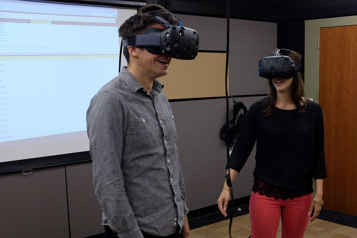 Recode's Mark Bergen and The Verge's Lauren Goode wearing HTC Vive virtual reality headsets at the Stanford University Virtual Human Interaction Lab