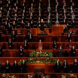A BYU student choir, top, speakers and church leaders stands during a choir performance of Saturday evening session of the 191st Semiannual General Conference of The Church of Jesus Christ of Latter-day Saints at the Conference Center in Salt Lake City on Saturday, Oct. 2, 2021.