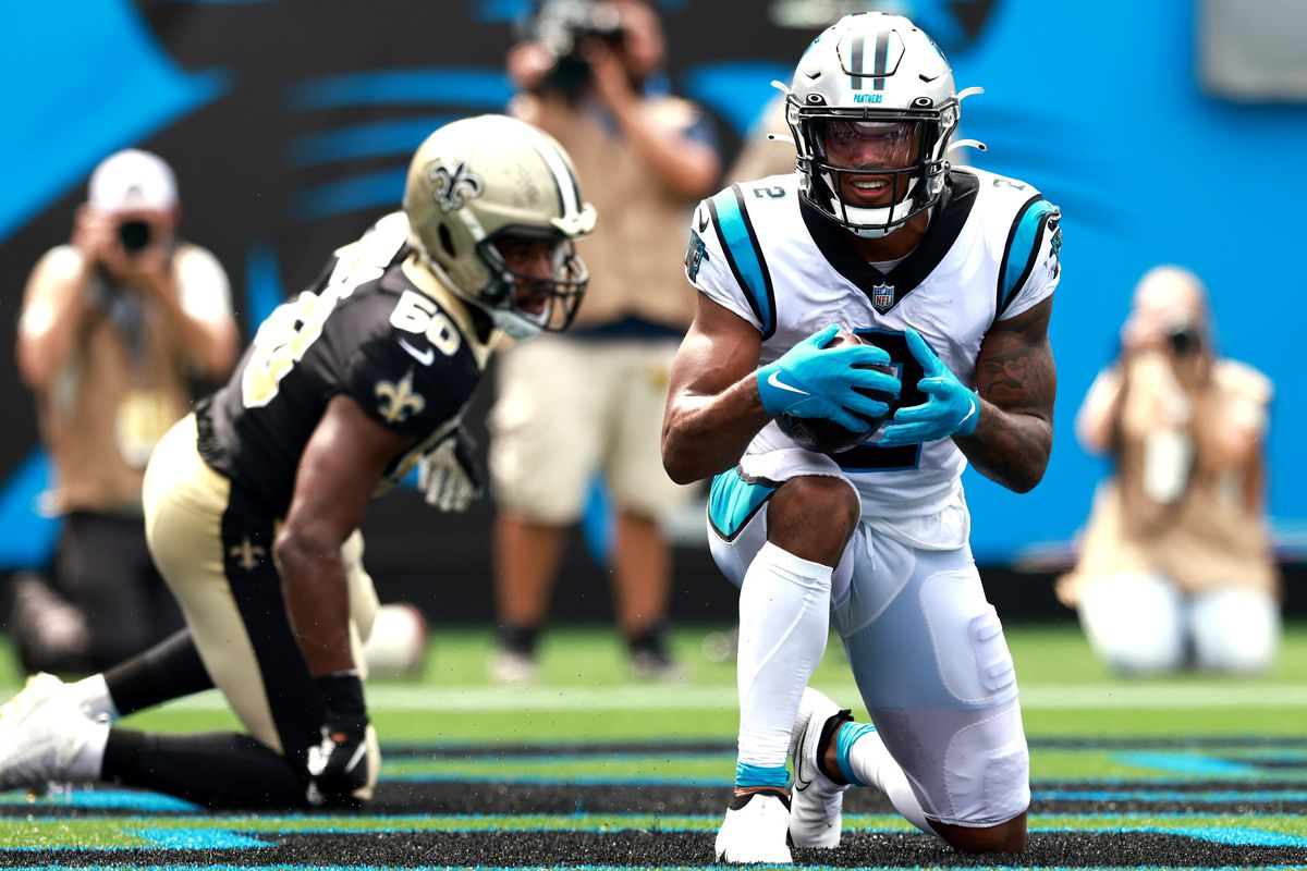 Wide receiver D.J. Moore #2 of the Carolina Panthers kneels in the end zone after scoring a touchdown in the game against the New Orleans Saints at Bank of America Stadium on September 19, 2021 in Charlotte, North Carolina.