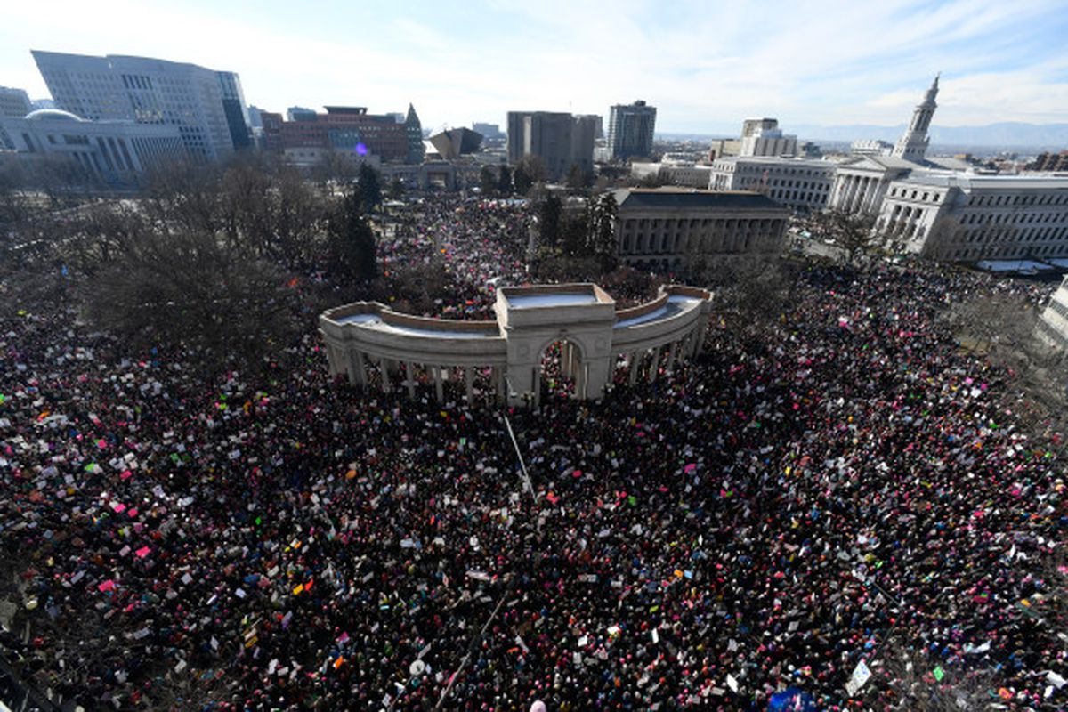 A crowd estimated at more than 100,000 filled Denver streets and Civic Center Park (Andy Cross, The Denver Post).