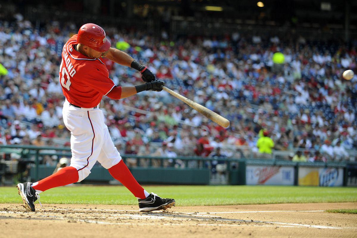 Jul 7, 2012; Washington, DC, USA; Washington Nationals shortstop Ian Desmond (20) hits a solo homer against the Colorado Rockies during the second inning at Nationals Park. Mandatory Credit: Brad Mills-US PRESSWIRE