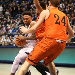 Brigham Young Cougars guard Jahshire Hardnett (0) drives the lane into the defense of Idaho State Bengals guard Brandon Boyd (15) and forward Blake Truman (24) as BYU takes on Idaho State at the Marriott Center in Provo on Thursday, Dec. 21, 2017.