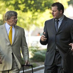FILE - In this July 13, 2012 file photo, former Major League Baseball pitcher Roger Clemens, right, and his attorney Rusty Hardin outside federal court in Washington. The Justice Department, embarrassed by an error that caused a mistrial of Clemens last year, has added more prosecutors in hopes of containing any missteps as it seeks to convict the famed pitcher of lying to Congress when he said he never used performance-enhancing drugs.