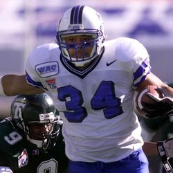 BYU's Kalani Sitake runs for yards with Tulane's Brett Timmons closing in on him during the Liberty Bowl on Dec. 31,1998, in Memphis, Tennessee.