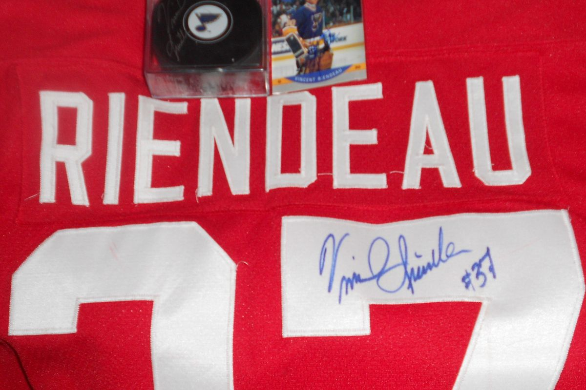 Game worn 1991 pre-tournament Canada Cup jersey signed by Vincent Riendeau, along with a signed Blues puck and signed card