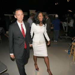 Mia Love and her husband, Jason Love, exit the studio following a debate Tuesday, Oct. 14, 2014, with Doug Owens at the KUED studios in Salt Lake City. Love and Owens are running for the 4th District congressional seat.