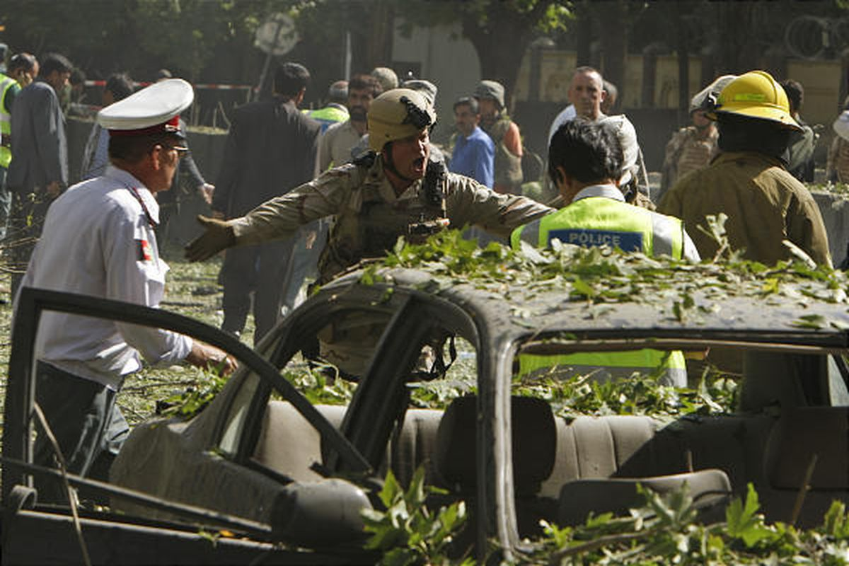 A U.S. soldier reacts after a suicide car bomb explosion that occurred near the main gate of NATO's headquarters in Kabul, Afghanistan, Saturday. Seven people were killed and nearly 100 wounded in the attack.