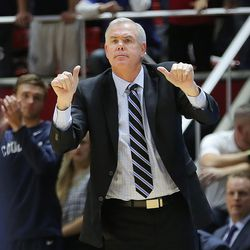 Brigham Young Cougars head coach Dave Rose calls a play as Utah and BYU play in the Huntsman Center in Salt Lake City Wednesday, Dec. 2, 2015. Utah won 83-75.