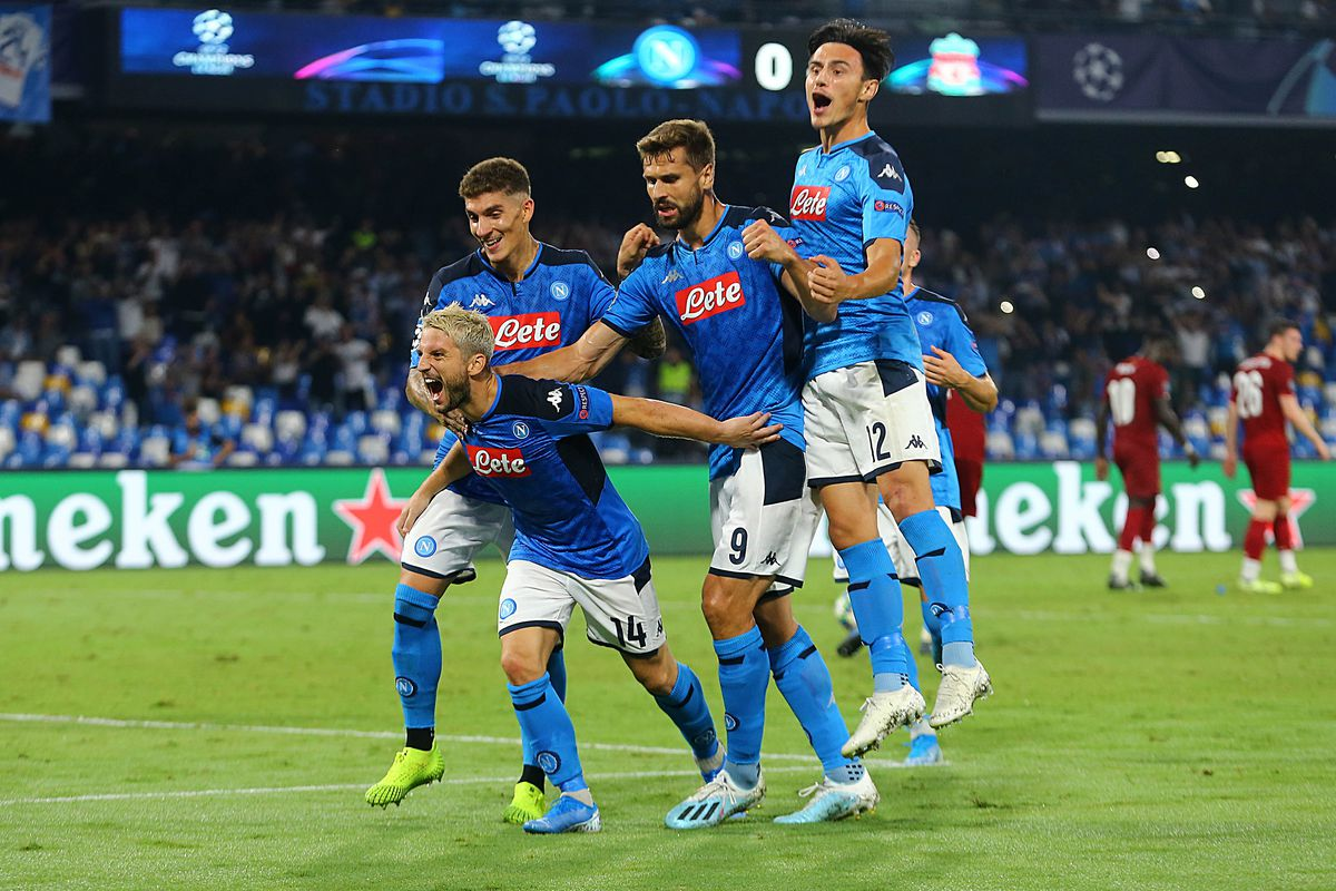 Napoli's belgian striker Dries Mertens (L) celebrates with...