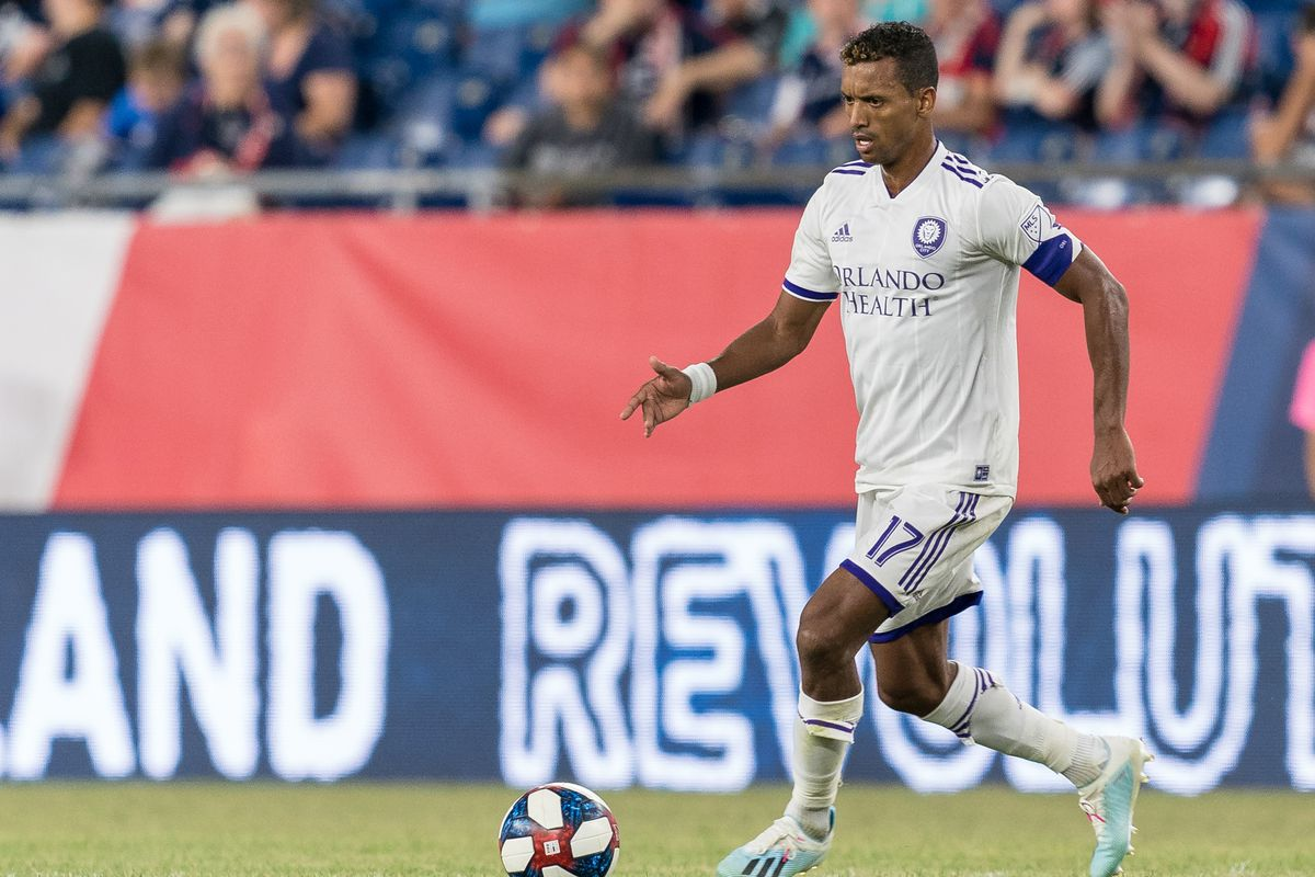 Nani of Orlando City dribbles during a game between Orlando City SC and New England Revolution at Gillette Stadium on July 27, 2019 in Foxborough, Massachusetts.