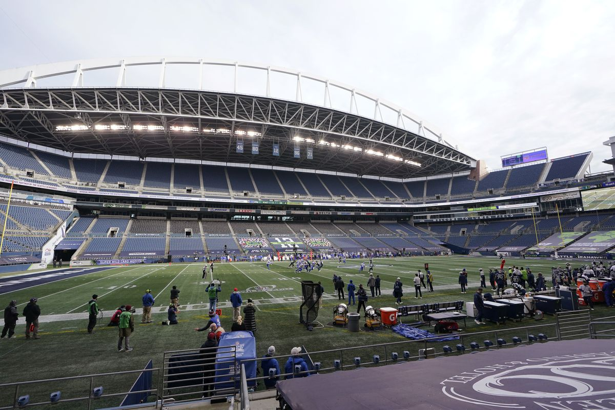 The Seahawks and Rams play a postseason game in an otherwise empty stadium in Seattle.