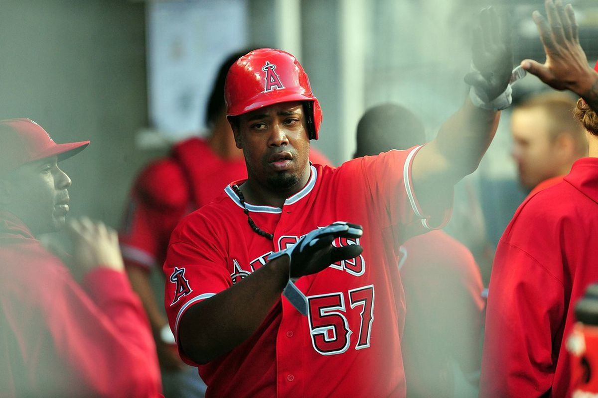 June 12, 2012; Los Angeles, CA, USA; Los Angeles Angels starting pitcher Jerome Williams (57) is congratulated after scoring a run in the third inning against the Los Angeles Dodgers at Dodger Stadium.  Mandatory Credit: Gary A. Vasquez-US PRESSWIRE
