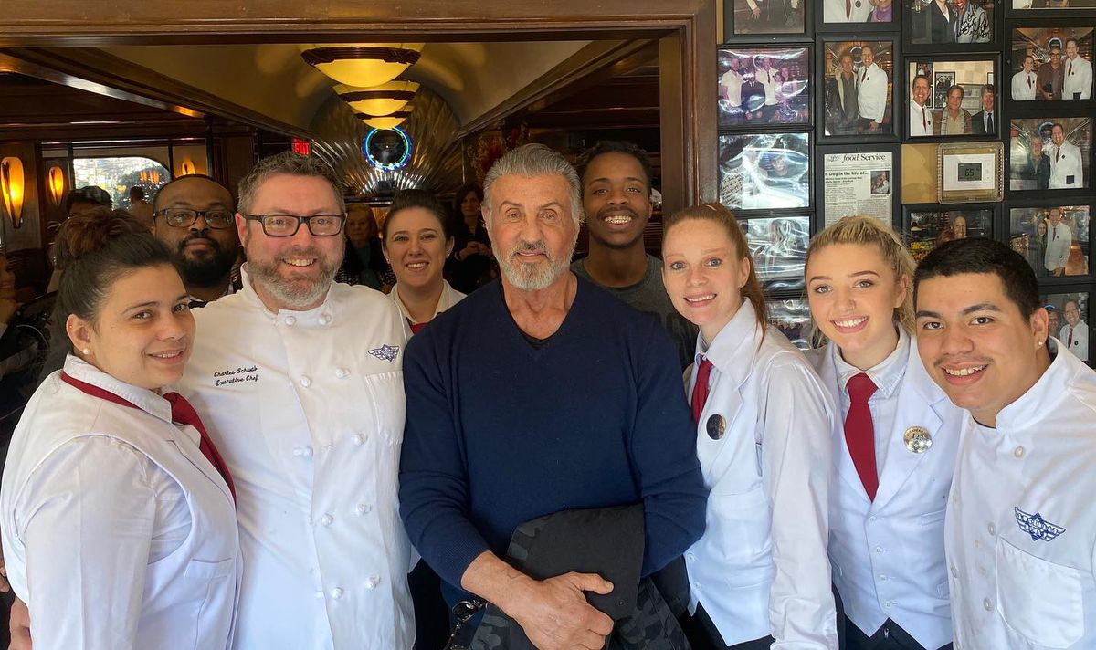 Actor Sylvester Stallone posing with Buckhead Diner employees in February 2020.