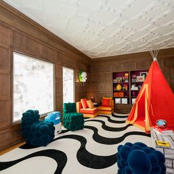 """Perhaps the wonkiest—and we mean that in a good way—room in the house was the called the """"Danger Zone."""" Designed by Martha Angus and Eche Martinez of <a href=""""http://marthaangus.com/"""">Martha Angus, Inc.</a>, the space was designed """"for fantasy"""