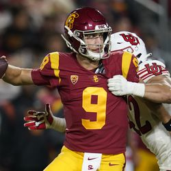 Southern California quarterback Kedon Slovis (9) throws under pressure from Utah defensive end Mika Tafua during the second half of an NCAA college football game Saturday, Oct. 9, 2021, in Los Angeles.