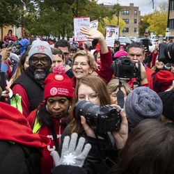 Presidential candidate U.S. Sen. Elizabeth Warren (D-MA) waves to supporters as she joins striking Chicago Teachers Union and SEIU Local 73 members for a speech on the picket line outside Oscar DePriest Elementary School on the West Side, Tuesday morning, Oct. 22, 2019.