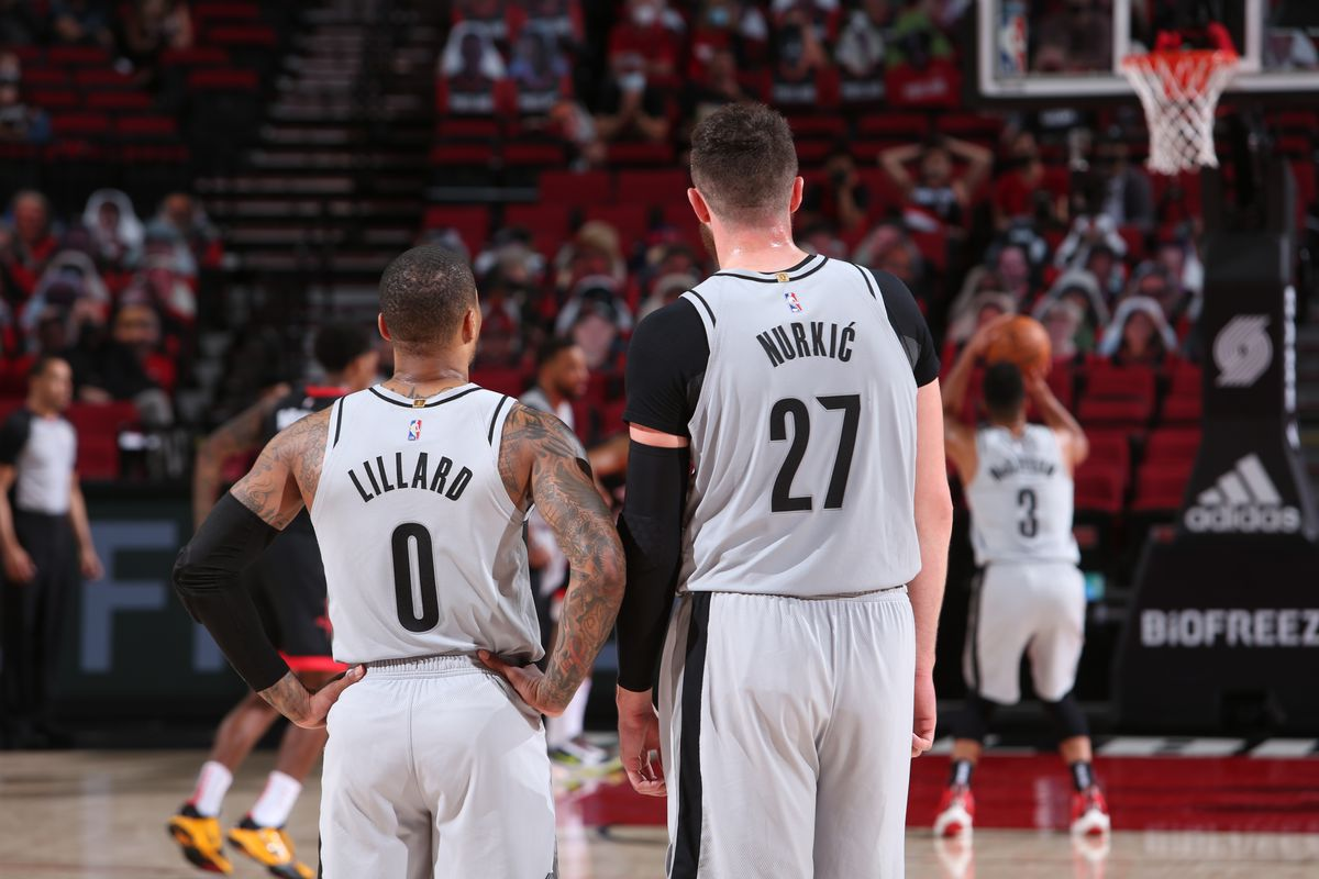 Damian Lillard and Jusuf Nurkic of the Portland Trail Blazers look on during the game against the Houston Rockets on May 10, 2021 at the Moda Center Arena in Portland, Oregon.
