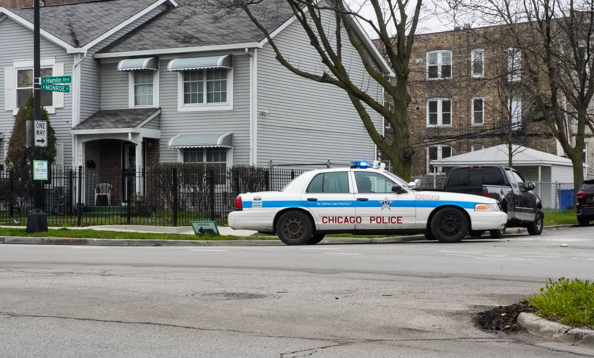 A Chicago Police Department squad car sits on a West Side street corner Friday morning.