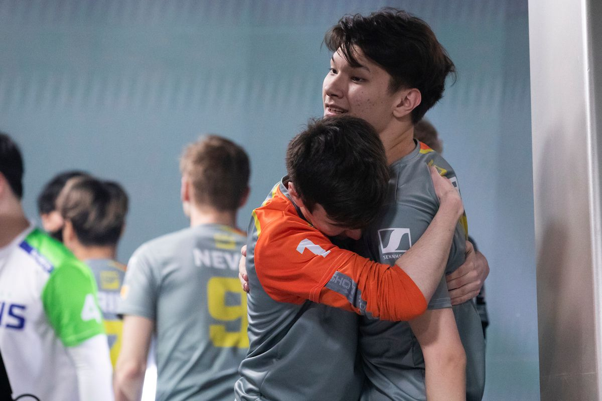 Overwatch League - players embrace on stage after a tough match