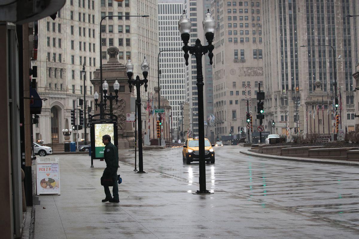 A man walks on deserted Michigan Avenue in Chicago.
