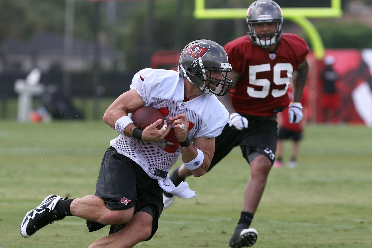 July 28, 2012; Tampa, FL, USA;  Tampa Bay Buccaneers tight end Dallas Clark (44) catches the ball and runs as linebacker Mason Foster (59) defends during training camp at One Buc Place. Mandatory Credit: Kim Klement-US PRESSWIRE