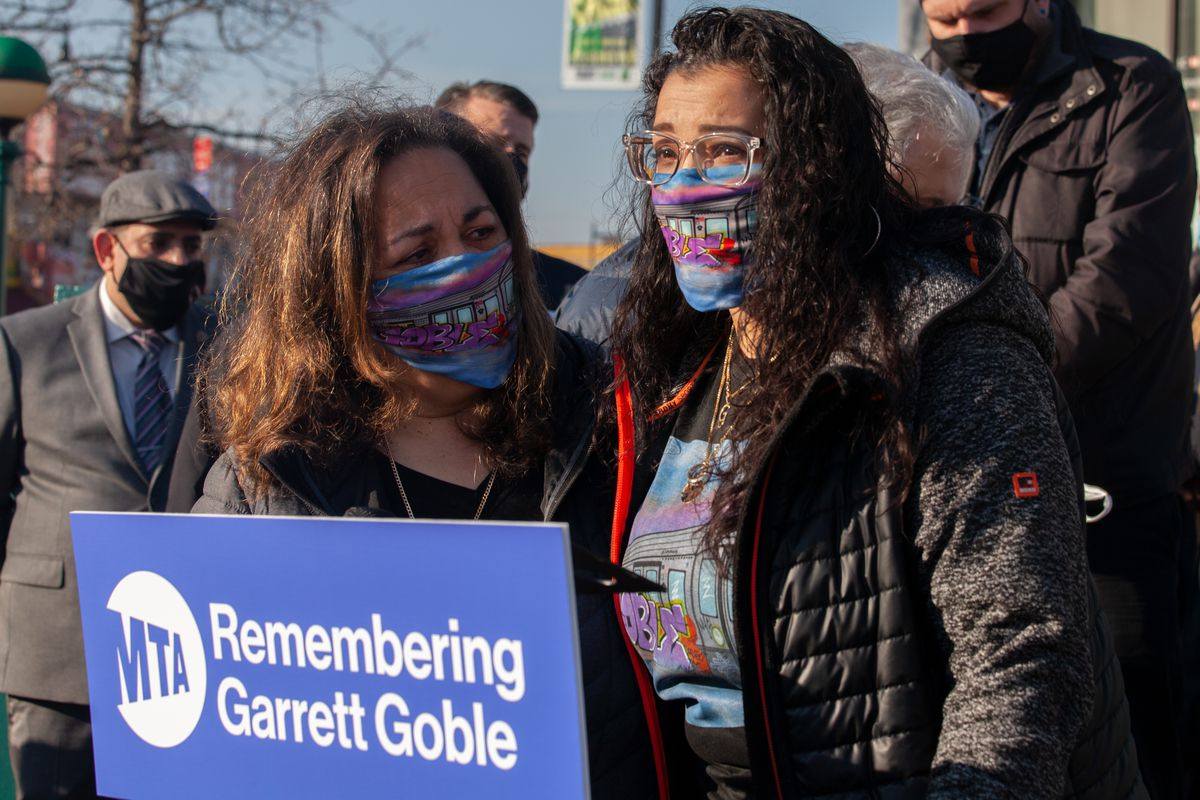 Garrett Goble's mother, Vicki (left), and widow, Delilah Rodriguez Goble,speak at a memorial ceremony at the Flatbush Avenue-Brooklyn College station, Dec. 21, 2020.