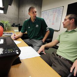 Utah Valley University men's basketball coach Mark Pope, left, works in his office in Orem with Assistant Athletic Director Todd Nebeker, Wednesday, April 29, 2015.