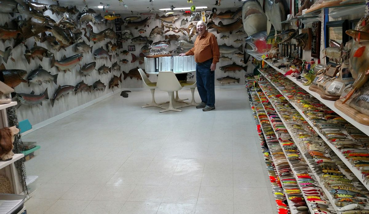 Don Dubin in what is about half of his museum-quality collection of fishing history in his basement.<br>Credit: Dale Bowman