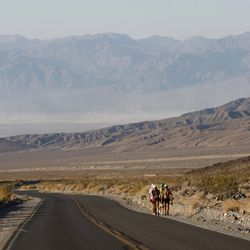 Oswaldo Lopez of Madera, California, Carlos Alberto of Portugal and support crew members climb the grade toward Townes Pass during the AdventurCORPS Badwater 135
