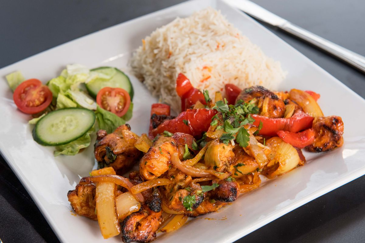 Boneless chicken with bell peppers and onions, served at Masala Square