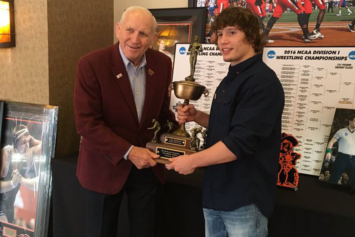 Dan Hodge, left, presents the trophy named after him to Oklahoma State's Alex Dieringer.