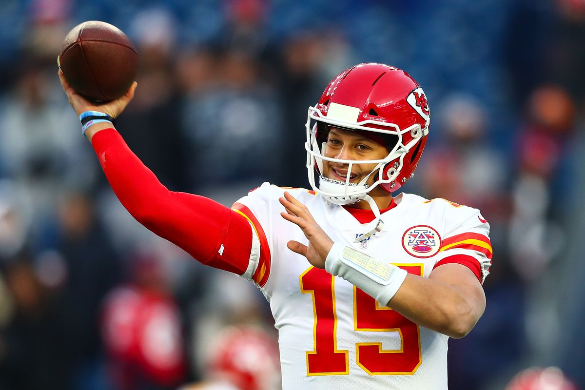 Patrick Mahomes of the Kansas City Chiefs throws the ball during warm ups before a game against the New England Patriots at Gillette Stadium on December 8, 2019 in Foxborough, Massachusetts.