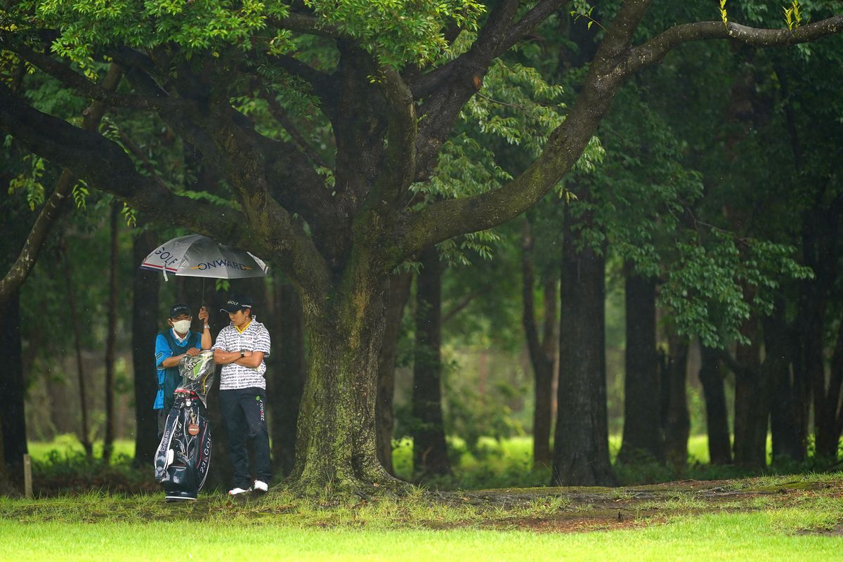 Misuzu Narita of Japan waits for the restart while suspension due to the rain on the 8th hole during the first round of the Earth Mondamin Cup at the Camellia Hills Country Club on June 25, 2020 in Sodegaura, Chiba, Japan.