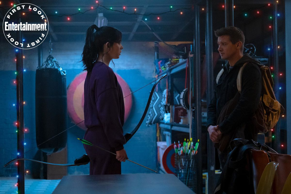 Kate Bishop, holding a bow and arrow, talks to Clint Barton in Disney Plus' Hawkeye