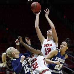 Utah Utes forward Emily Potter (12) takes a shot against Montana State Bobcats forward Riley Nordgaard (15) and forward Alexa Dawkins (22) defending during NIT women's basketball action in Salt Lake City, Friday, March 18, 2016.