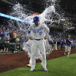 Hunter Dozier is doused after a win against the Twins.