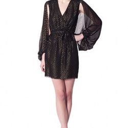 "<a href=""http://www.erinfetherston.com/shop/archive-sale-2/cape-sleeve-wrap-dress-2.html"">Lurex Dot Cape Sleeve Wrap Dress</a>, $99 (was $375)"