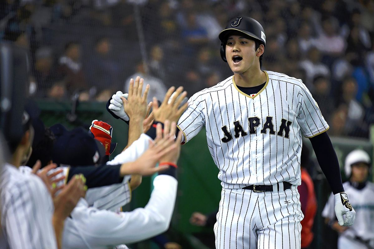 TOKYO, JAPAN - NOVEMBER 12:  Shohei Ohtani #16 of Japan celebrates after hitting a solo homer in the fifth inning during the international friendly match between Japan and Netherlands at the Tokyo Dome on November 12, 2016 in Tokyo, Japan.  (Photo by Masterpress/Getty Images)
