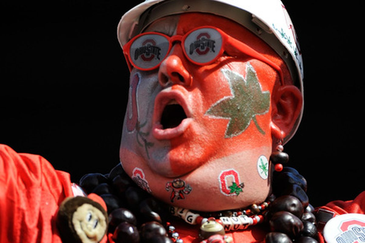 COLUMBUS OH - SEPTEMBER 18:  An Ohio State Buckeyes fan cheers on his team as they cruise to a 43-7 win over the Ohio Bobcats at Ohio Stadium on September 18 2010 in Columbus Ohio.  (Photo by Jamie Sabau/Getty Images)