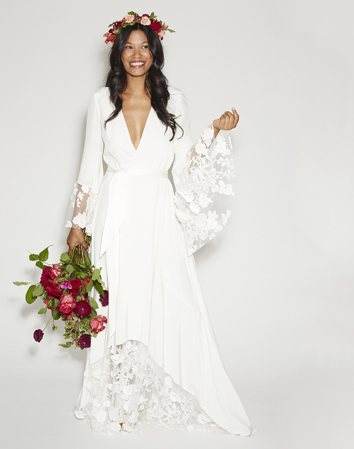Where to buy a wedding dress racked a model in a vintage looking wedding gown with sleeves and a flower crown izmirmasajfo