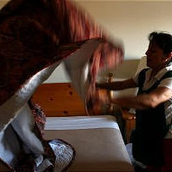 """""""Sarah"""" prepares a bed in a northern Utah hotel. She emigrated illegally 10 years ago with her husband. They have three children and plan to return to Mexico City sometime."""